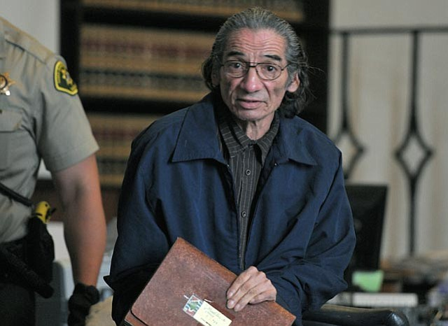 """June 23, 2011 -- Samuel Joseph """"Joe"""" Martinez, accused of beating a homeless women in 2006 so severely that she was put in a coma for several days, leaves the courtroom on the second day of his jury trial."""