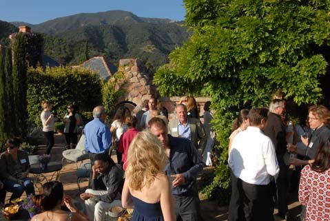 Guests on the patio at Kay and Dave Petersons' lovely Romero Canyon home.