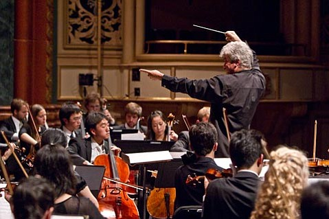 Maestro Peter Oundjian leading the Academy Festival Orchestra.