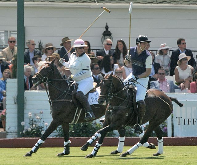 Melissa Ganzi and Prince William on the polo field at the Santa Barbara Polo and Racquet Club on Saturday as former Ambassador to Jamaica Glen Holden and Kate Middleton (center) watch from the grandstands.