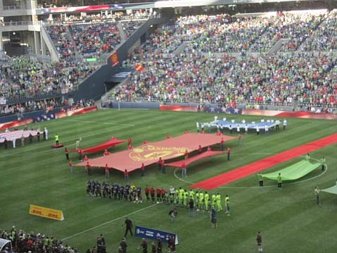 The starting teams stood for the U.S. anthem in front of a crowd of 67,052.