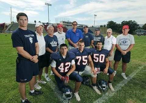 San Marcos football. Coach Jeff Hesselmeyer center in blue polo shirt.