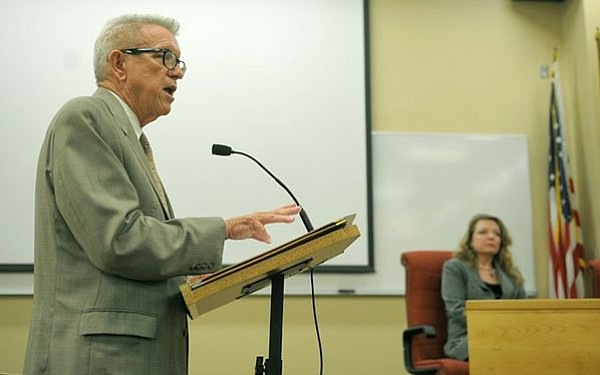 Following a more than nine-hour closed session, attorney Craig Price describes the preliminary terms reached in the paid leave and subsequent 2012 termination of SBCC president Dr. Andreea Serban at 3:30 a.m. Friday morning July 29, 2011