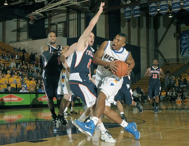 UCSB Orlando Johnson (center) in a game against Cal State Fullerton Feb. 17, 2011.