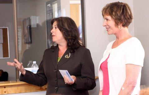 Didi Reynoso and Judy Markline of Women's Fund Present Check