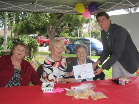 (from left to right) Garden Court residents, Betty Beraldo, Elizabeth Wright and Phyllis Kubilus accept a certificate of appreciation on behalf of Garden Court volunteers from Damon Taugher, Director of Direct Relief USA.  Garden Court residents have raised over $600 in the last few months through cookie sales for Direct Relief USA's response to weather related emergencies throughout the nation, providing medical supplies and support for those affected.  Over the years, Garden Court seniors have raised about $24,000 for charitable causes, including Direct Relief.