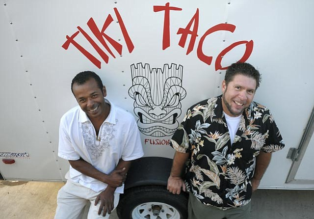Tiki Taco owner Eric Bonilla (right) and marketing rep Rich Arzola.