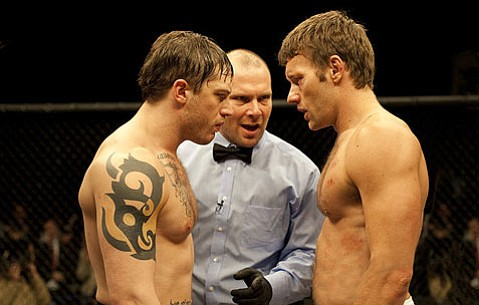 <strong>FIGHT-FLICK FUN:</strong>  Tom Hardy (left) and Joel Edgerton star as two brothers whose careers as MMA fighters converge in a caged bout against each other in <em>Warrior</em>.
