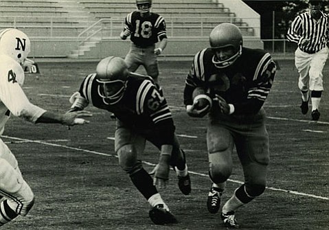 Tom Broadhead carries the football next to UCSB teammate Bart Weitzenberg (#67).