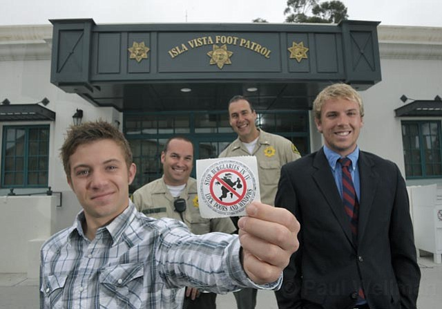 Left to right: Associated Students President Harrison Weber, Sheriff's Deputy Anthony DeLeo, Sheriff's Lt. Ray Vuillemainroy, and Associated Students V.P. of Local Affairs Tim Benson