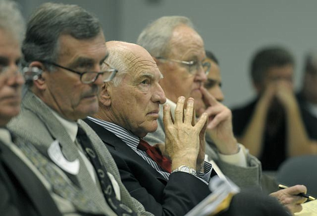 Michael Keston (center) listens as Goleta Gity Council unanimously denies studying the possible rezoning of Bishop Ranch for development Sept. 20, 2011