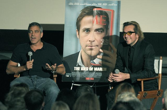 At the Riviera Theatre last Saturday, Roger Durling (right) interviewed George Clooney about why he pursued politically charged films as a director, such as his latest film, <em>The Ides of March</em>, which opens this weekend nationwide.