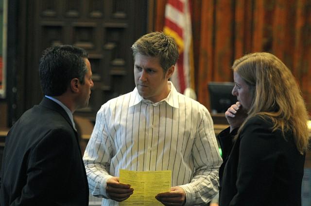 Joshua Braun (center) speaks to attorney Josh Lynn