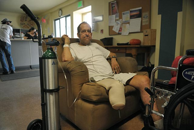 """William """"Kickstand"""" Armstrong sits in a chair at Casa Esperanza, where he is recovering from pacemaker surgery and a three week long induced coma. He is one of hundreds of homeless people who are discharged from Cottage Hospital each year."""