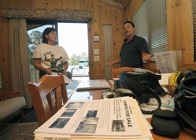 Central Coast Cabins owners Ernie and Shirley Del Rio are being forced to close their operations at Cachuma Lake.