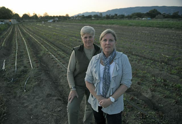 """<strong>GROWING OPPOSITION:</strong> Barb Kloos (right) has lived in the Eastern Goleta Valley for 25 years, but is """"very, very nervous"""" that the region's semi-rural lifestyle could change because the state is forcing the county to consider changing farmland into high density housing. She, Terri Ortega (at left), and others involved with the Eastern Goleta Valley Coalition also fear proposed secondary uses for the remaining ag lands, such as bed-and-breakfasts. """"This is a huge policy,"""" said Kloos. """"It's not like you want to add 10 parking space at Vons."""""""