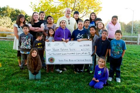 Tribal youth from the Santa Ynez Band of Chumash Indians Tribe demonstrated 'amuyich (Samala for generosity) when they presented a check in the amount of $2,765 to People Helping People's food program last week.
