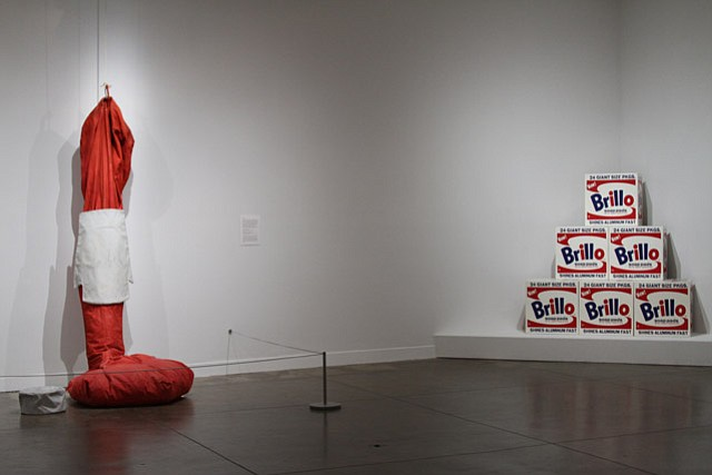 "Claes Oldenburg's soft sculpture ""Giant Bottle of Ketchup with Ketchup"" (1966) currently shares gallery space with Andy Warhol's ""Brillo Boxes"" (1964) at the Pacific Asia Museum in Pasadena."
