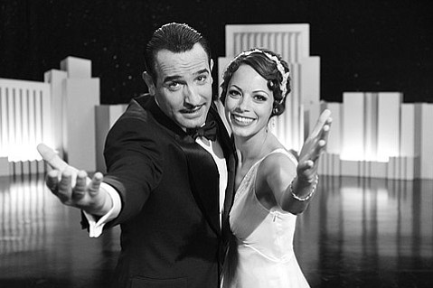 Jean Dujardin (left) and Bérénice Bejo (right) star as George Valentin and Peppy Miller in <em>The Artist</em>.