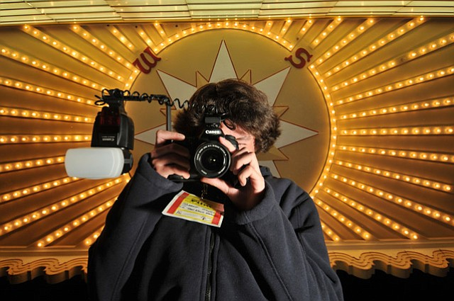 Teen photog Garrett Geyer aims and shoots on the Arlington red carpet.