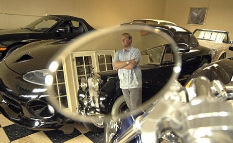 Adam Taylor on the showroom floor of Montecito Motors Oct. 10, 2003
