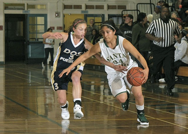DP Charger Chiara DiMarco (left) goes up against S.B. Don Ivette Gil, the game high scorer, at Santa Barbara High.
