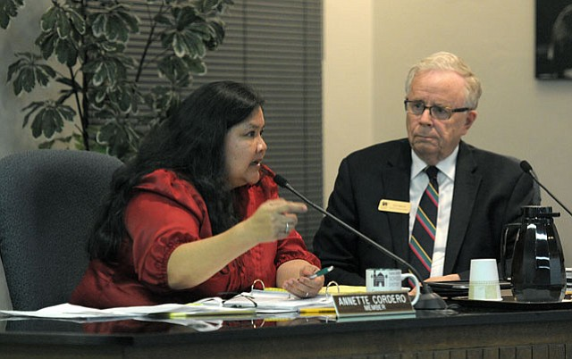 "<strong>TAKING AIM:</strong> After Boardmember Annette Cordero (left) expressed concern that drug-detecting dogs on school sites might be used as a tool to further target Latinos, Ed Heron (right) replied, ""We are targeting illegal drugs."""