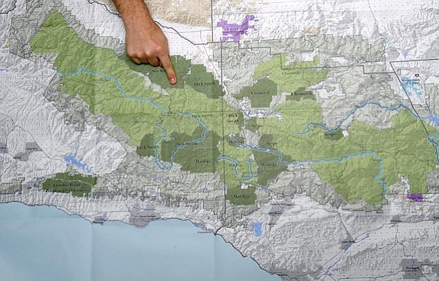 In June 2011, Los Padres ForestWatch's Jeff Kuyper points to the dark green areas that represent the 200,000 acres of new wilderness areas that was being considered. The number of acreage has come down considerably since then.