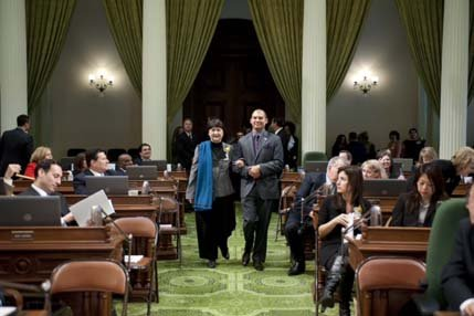 "Assemblyman Das Williams escorts human Rights Activist from Santa Barbra, Dr. Victoria Riskin, during a special floor ceremony Monday at the State Capitol honoring California's ""Women of the Year."""