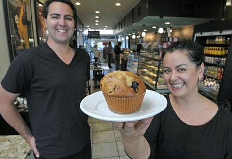 Xanadu French Bakery's Davis Miller and Sahar Eskandarifar with a blueberry muffin.