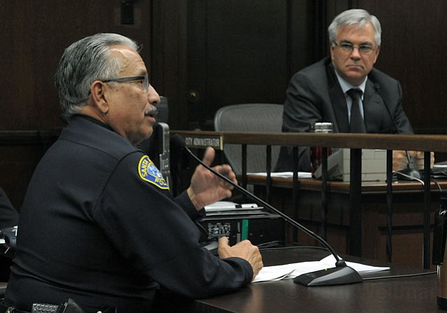 Police Chief Cam Sanchez addresses the council. City Administrator Jim Armstrong looks on.
