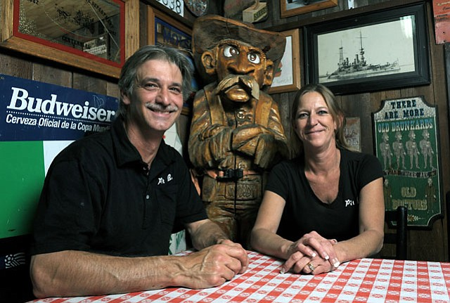 Woody's owners Gino and Kim Stabile.
