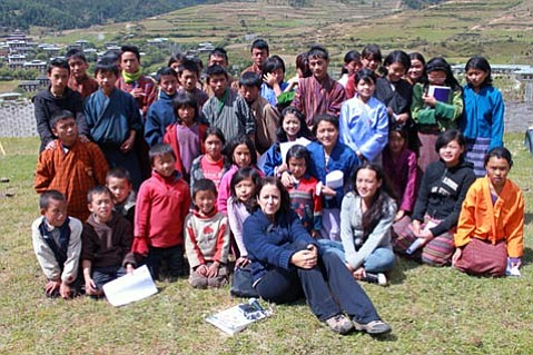 This week, author Lisa Napoli ( center front )will discuss her transformative time volunteering for a Bhutanese radio station.