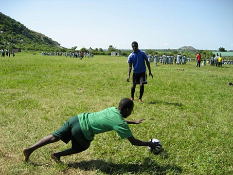 Davies Kabogoza (middle ground) works a soccer clinic in Uganda on June 30, 2010.