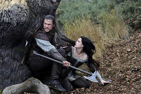 Kristen (<em>Twilight)</em> Stewart and Chris (<em>Thor</em>) Hemsworth star as the title characters in the revisionist <em>Snow White and the Hunstman</em>.