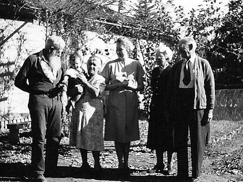 "The Jones clan circa 1952 (left to right): Clarence Mead ""CM"" and Magdalena Jones with grandson Robert, daughter Doris Mae Jones, and CM's sister and brother-in-law Grace and Ira Hendricks stand in front of the family's Edison Street home."