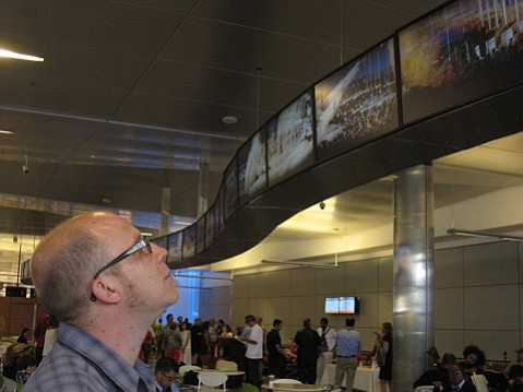 "Ryan Lamb's ""Five Dimensional Parade"" is part of the airport's new exhibit of video art."