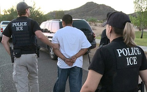 <b>ICE BRINGS THE HEAT:</b>  Immigration and Customs Enforcement (ICE) officials detain a suspected illegal immigrant.