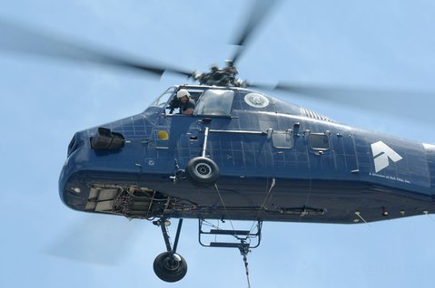 A 1956 Sikorsky S-58ET helicopter is used to place new HVAC units on Dos Pueblos High School rooftops (July 11, 2012)