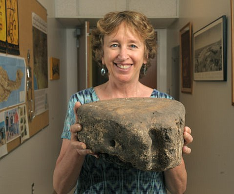 Archaeologist Lynn Gamble holds a whale vertebra that may have been used by the Chumash as a stool.