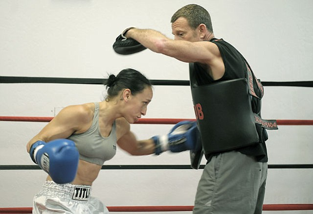 State Street Boxing club fighter Federica Bianco spars with coach Josh Schneyer. (July 12, 2012)