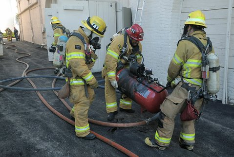Responding to reports of smoke on the 600 block of State Street, Santa Barbara firefighters find a burning air compressor in the basement of Velo Pro Cyclery (Aug 13, 2012).