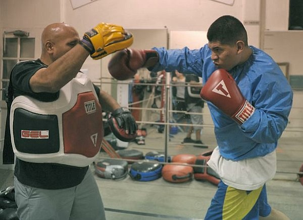 Celso Campoberde, a 24 year-old that has been coming to Primo Boxing Club for eight years, trains in the ring with Joe Pommier (June 27, 2011)