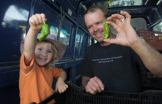 """Robert Abbott and """"almost 4-year-old"""" daughter Edie with shishito peppers."""