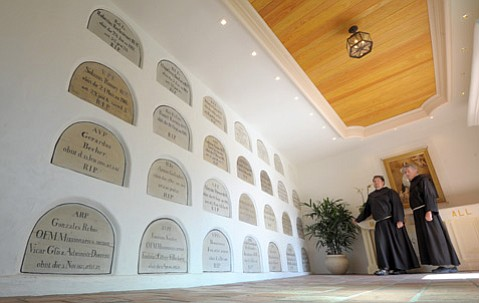 Brother Eric Pilarcik (left) and Father Richard McManus at the Old Mission's revamped mausoleum.
