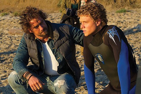 Fresh-faced surfer Jay Moriarity (Jonny Weston) seeks out grizzled big-wave guru Frosty Hesson (Gerard Butler) to teach him the way of the wave in the melodramatic guilty pleasure <i>Chasing Mavericks</i>.