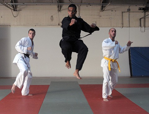 Amitabh Ghoshal (center) demonstrates his moves along with students Trevor Zwick (left) and Sina Omidi.