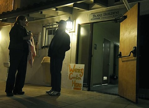 Dr. Lynn Jahnke and John Buttney outside the warming center at the Unitarian Church Monday night Jan. 18, 2010.