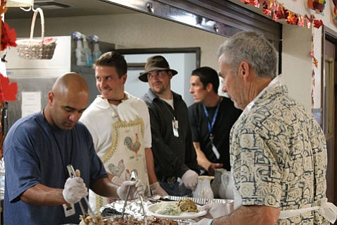 Members of the Rescue Mission's Residential Recovery Program serve Thanksgiving meals to volunteers and guests.