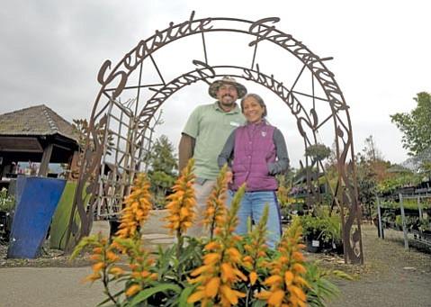 Seaside Gardens Office Manager Diana Sandner and Alex Martinez.